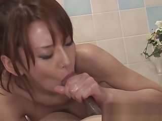 Asian babe massages the brush cadger with the brush soapy wet body