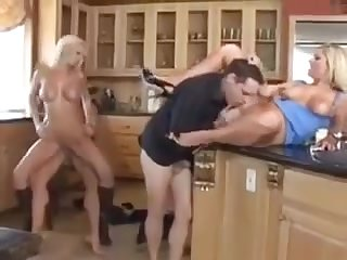 Couples wife swapping in the kitchenette