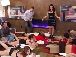 Hot swingers getting playful on someone's skin carpet