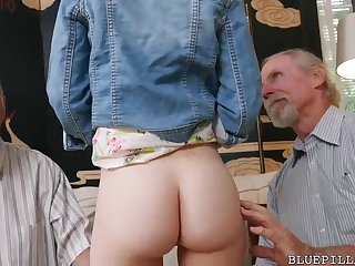Crimson haired sweetheart is having casual bang-out just about 2 old dude in her living cell