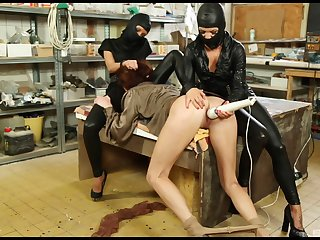 Masked lesbian sluts abuse Bella Baby with toys in the scullery