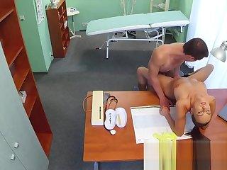 Nurse fucks stud while doctor is broadly