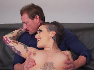 Tattooed model Rizzo Ford gives a blowjob before getting fucked