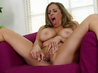 Busty mature Sienna Lopez opens her legs to play with a dildo
