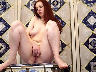 Redhead amateur babe Alice Enchanted forest spreads her legs to move